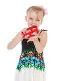 Laughing girl knocks on the tambourine Stock Image