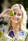 Laughing girl with limes in park Stock Photography