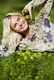 Laughing girl with limes in park Stock Photos