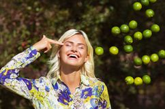 Laughing girl with limes in park royalty free stock photo