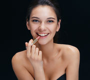 Laughing girl with lipstick. stock images
