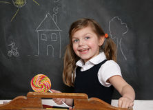 Laughing girl with lollipop Royalty Free Stock Photos