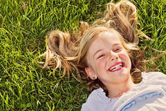 Free Laughing Girl Lying In Grass Stock Photo - 22292940
