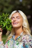 Laughing girl with mint in park Royalty Free Stock Images