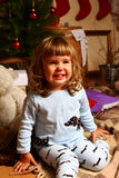 Laughing girl with a new year or Christmas tree Royalty Free Stock Image