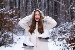 Laughing Girl Outdoors. Christmas girl outdoor portrait. Young woman winter portrait. Snowing winter beauty fashion royalty free stock photography