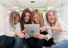 Laughing girl with pc tablet Royalty Free Stock Photo