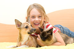 Laughing girl. A laughing girl with pets Stock Photos