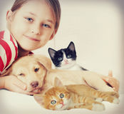 Laughing girl. A laughing girl with a pets Stock Image