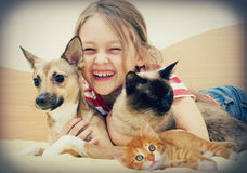 Laughing girl and pets. In retro style Stock Image