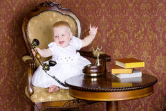 Laughing girl with the phone in vintage interior Stock Photography