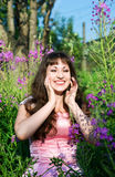 Laughing girl in pink dress Stock Photos