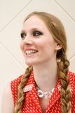 Laughing girl with plaits royalty free stock photography