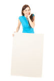 Laughing girl presenting something with blank sign Royalty Free Stock Image