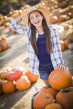 Laughing Girl with a Pumpkins at the Pumpkin Patch Royalty Free Stock Photos