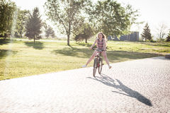Laughing girl riding on bicycle Stock Photography