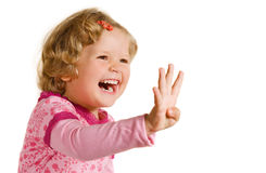 Laughing girl in rose dress. Laughing girl is showing four fingers Stock Images