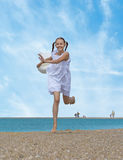 Laughing girl runs along the beach stock images