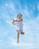 Laughing girl runs on the clouds Royalty Free Stock Images