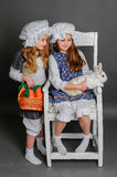 Laughing girl in a rustic style with the Easter bunny, carrot an. Laughing girl in a rustic style with the Easter bunny Royalty Free Stock Photography