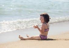 Laughing  girl  on sand beach Stock Photos