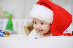 Laughing Girl in Santa Claus Cap Royalty Free Stock Images