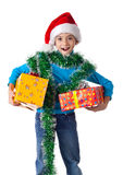 Laughing girl in Santa hat with gift boxes Stock Photography