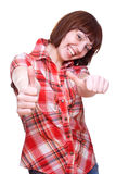 Laughing girl in a shirt giving thumbs-up Stock Images