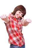 Laughing girl in a shirt giving thumbs-up Stock Photography
