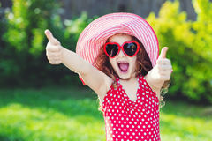 Laughing girl showing thumbs up. Stock Photo