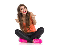 Laughing Girl Sitting With Legs Crossed Stock Image