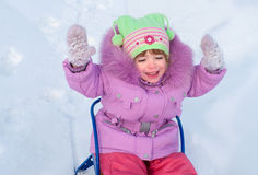 The laughing girl  sledging Royalty Free Stock Image