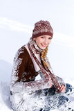Laughing girl on the snow outdoors Royalty Free Stock Photography