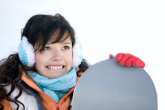Laughing girl snowboarder Stock Photo