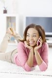 Laughing girl speaking on mobile royalty free stock images