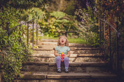 Laughing girl on stairs Stock Image