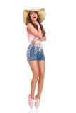 Laughing Girl in Straw Hat Standing On Tiptoe Stock Images