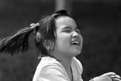 Laughing girl at the summer park Royalty Free Stock Photo