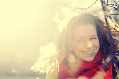 Laughing girl in sunlight Stock Image
