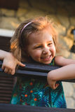 Laughing Girl in Sunset Light. At porch Stock Photo