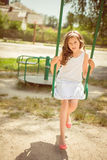 Laughing girl on a swing Stock Photos