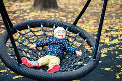 Laughing girl swinging Stock Photo