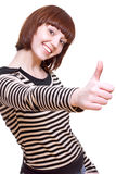 Laughing girl in a T-shirt giving thumbs-up royalty free stock image