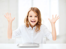 Laughing girl with tablet pc computer and hands up Royalty Free Stock Images