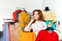 Laughing girl talking on mobile and shopping Stock Photo