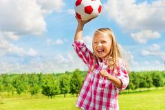 Laughing girl throwing ball Royalty Free Stock Images