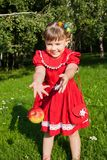 Laughing girl throwing up redapples Royalty Free Stock Photos