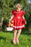 Laughing girl throwing up redapples Stock Photo
