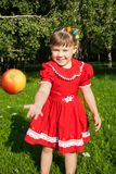 Laughing girl throwing up redapples Royalty Free Stock Image
