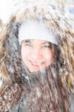 Laughing girl under snow Stock Photo
